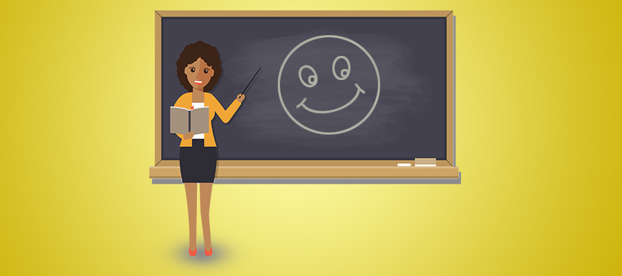 Image of a teacher drawing a smiley face