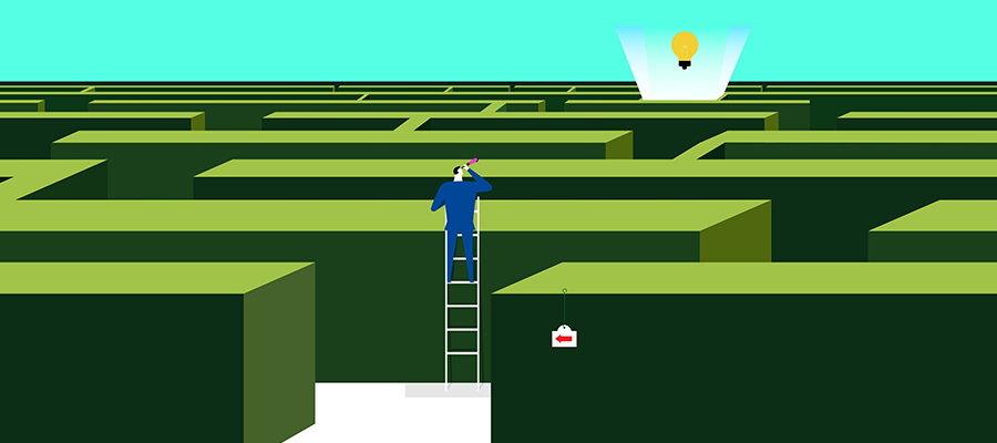 Drawing of a man looking over a maze